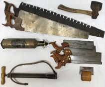 A collection of vintage tools to include two large wooden handled saws, largest with large tooth