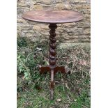 A mahogany circular topped side table with a barley twist stem. 45cms w x 71cms h.Condition