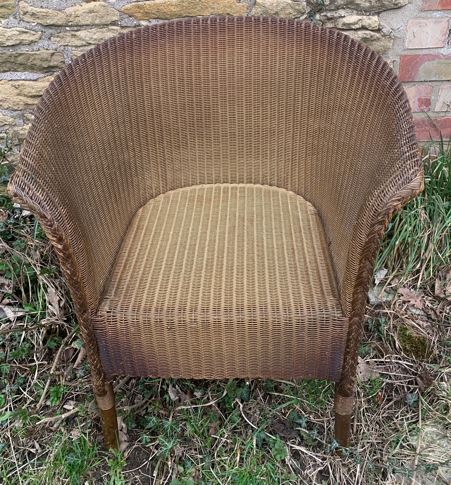 A Lloyd loom wicker armchair gilt painted. Height to seat 37cms, to back 68cms h x 58cms w.Condition