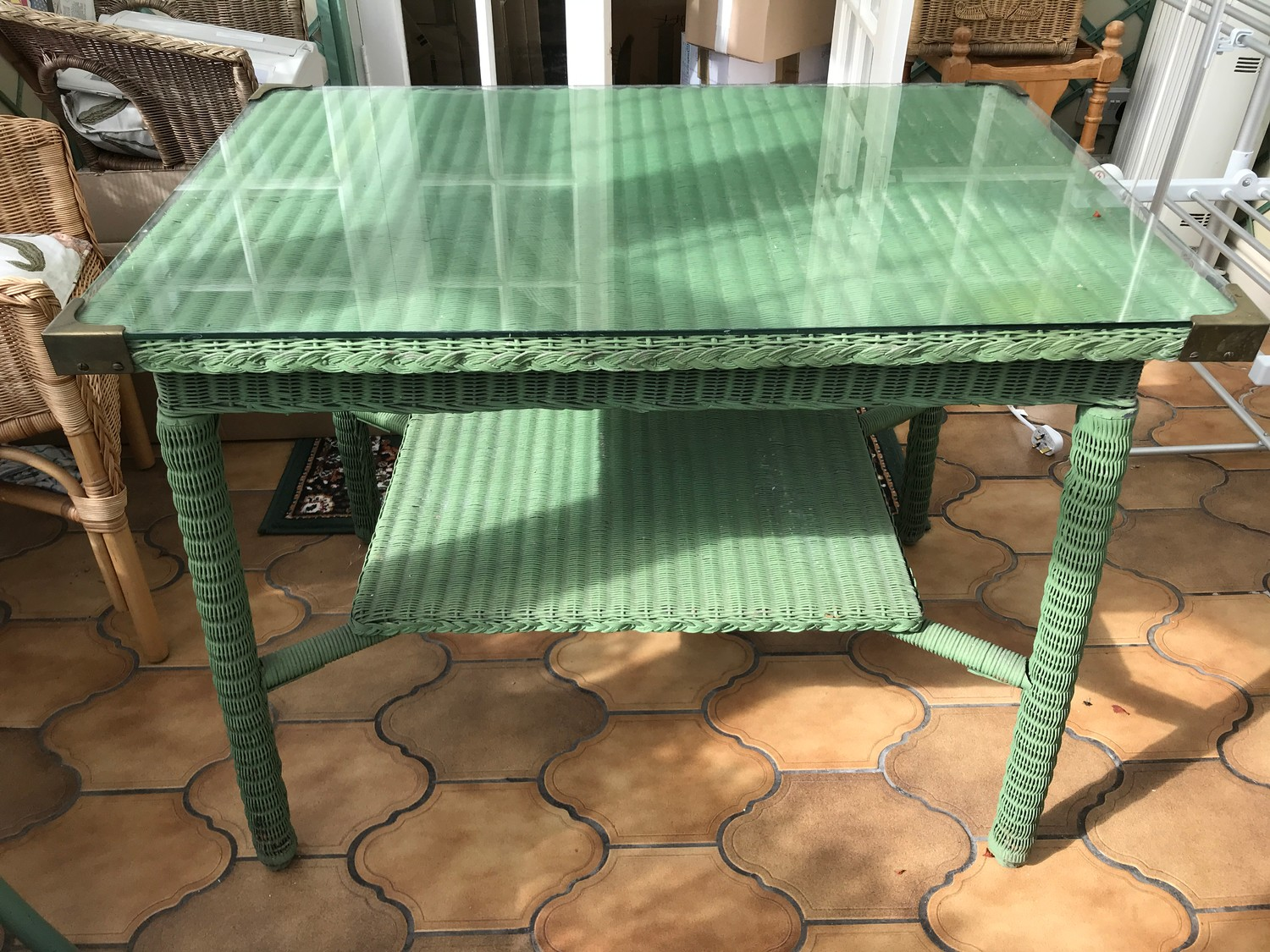 A green loom table with glazed top. 61 x 92 x 72cms h.Condition ReportGood condition. - Image 2 of 2