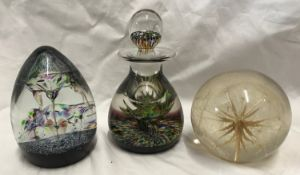 A Caithness glass paperweight 11.5cms h and an ink bottle with stopper 14cms h together with another
