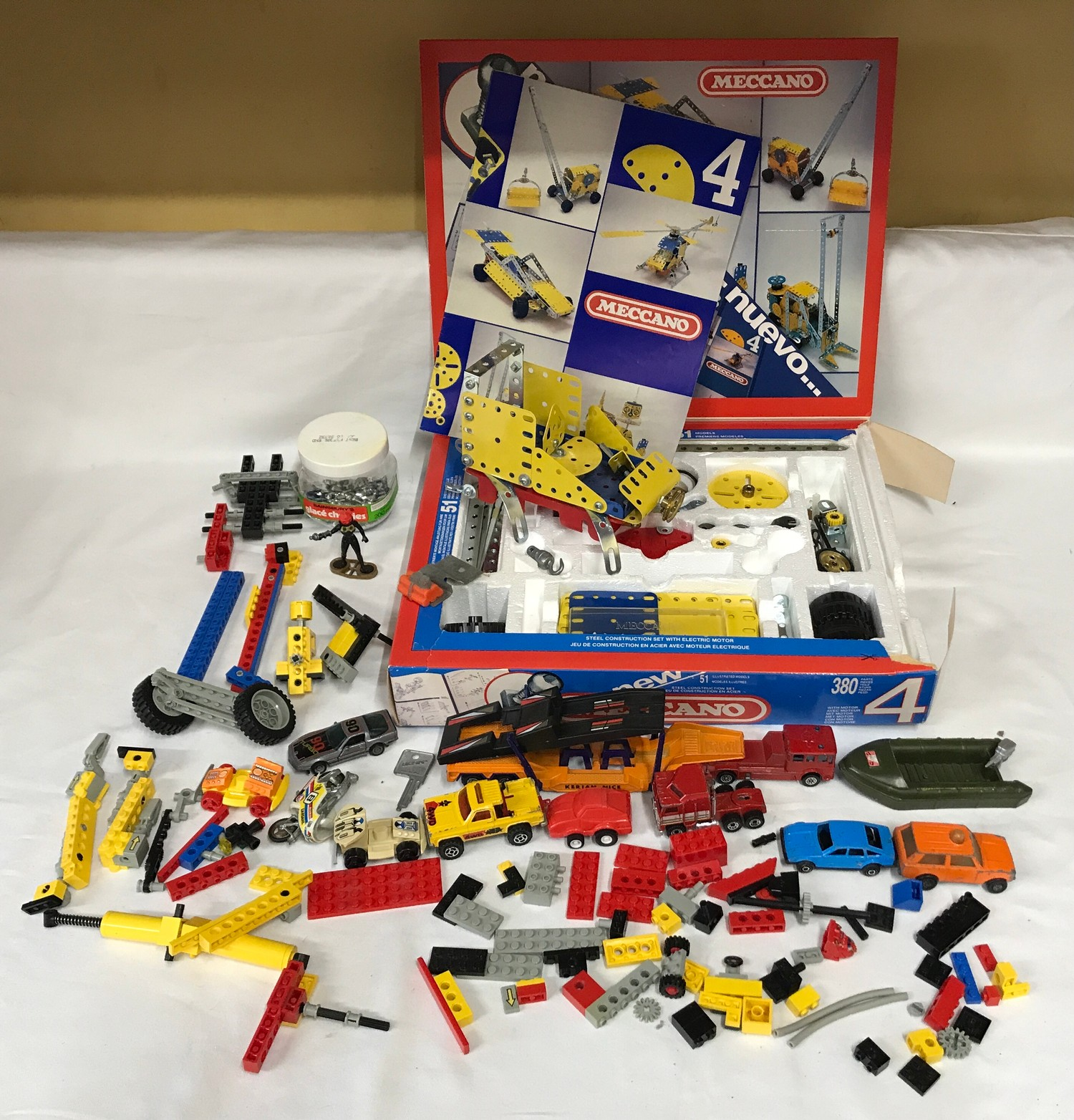 Meccano set number 4, boxed, assorted Lego pieces and plastic vehicles, playworn.Condition