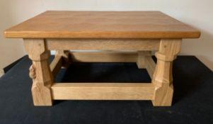 A light oak Robert (Mouseman) Thompson footstool with adzed top. 40cms x 28cms x 20cms h.Condition