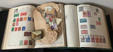 Two stamp albums filled with British and commemorative stamps with some loose stamps.Condition