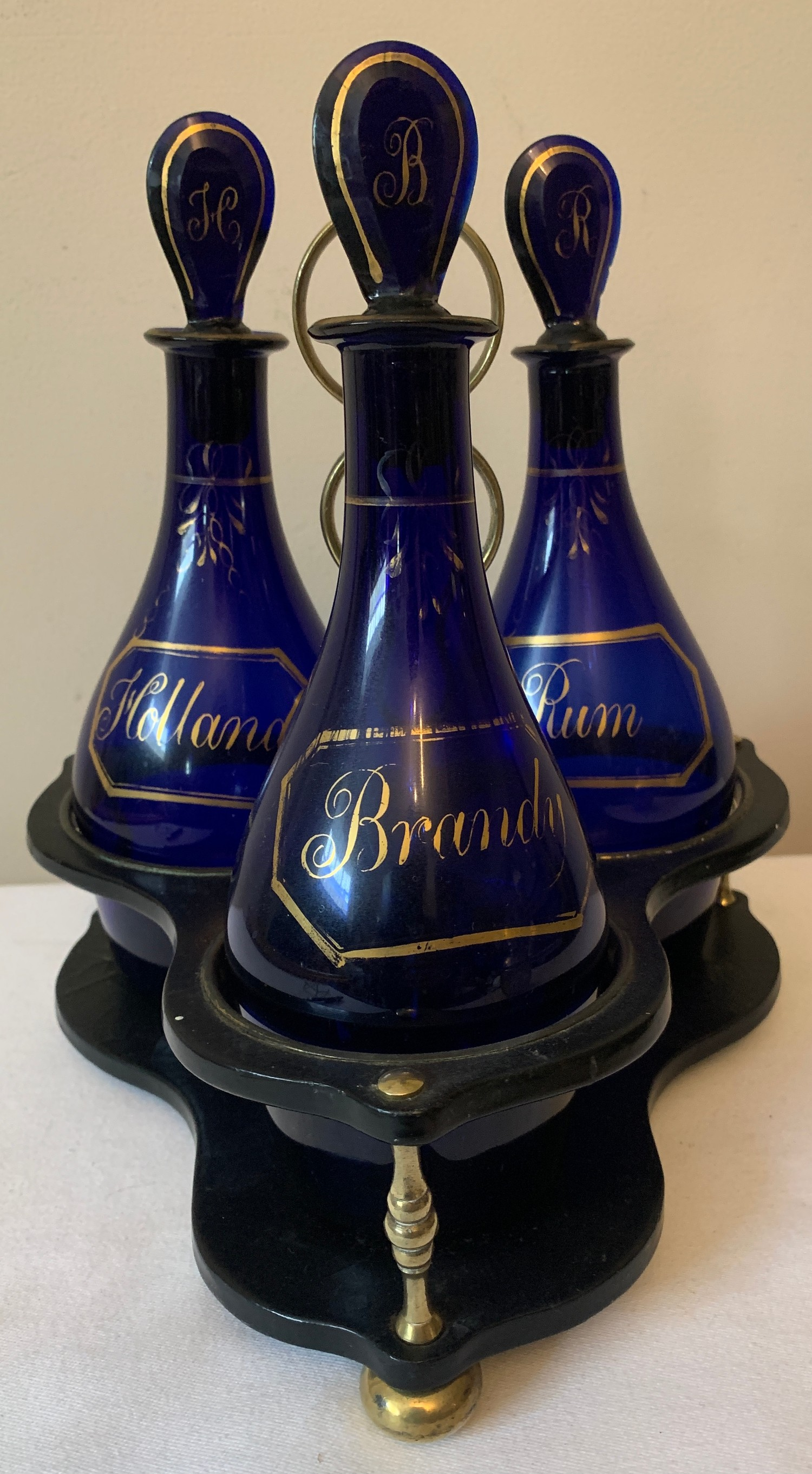 Three early 19thC Bristol Blue bottle decanters on paper mache and brass stand. Comprises of - Image 2 of 8