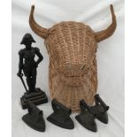 A cast iron doorstep of The duke of Wellington 41cms h, four hot irons and a large wicker wall
