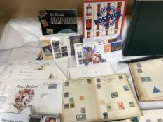 A box of miscellaneous stamp albums and coins.