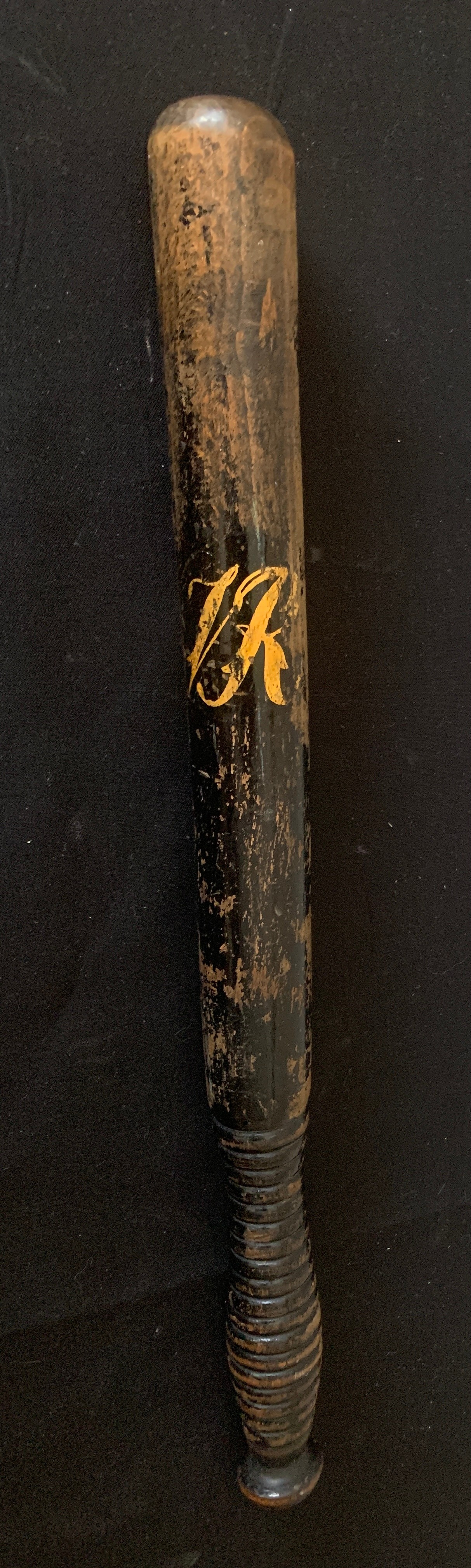 """A Victorian truncheon with """"VR"""" in gilt to front and ribbed handle. 45cms l.Condition ReportWear"""