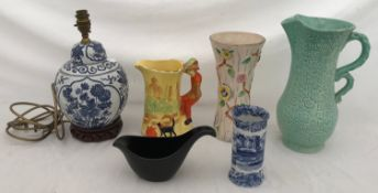 A mixed lot of ceramics to include a blue and white lamp on a wooden base, an Arthur Wood jug and