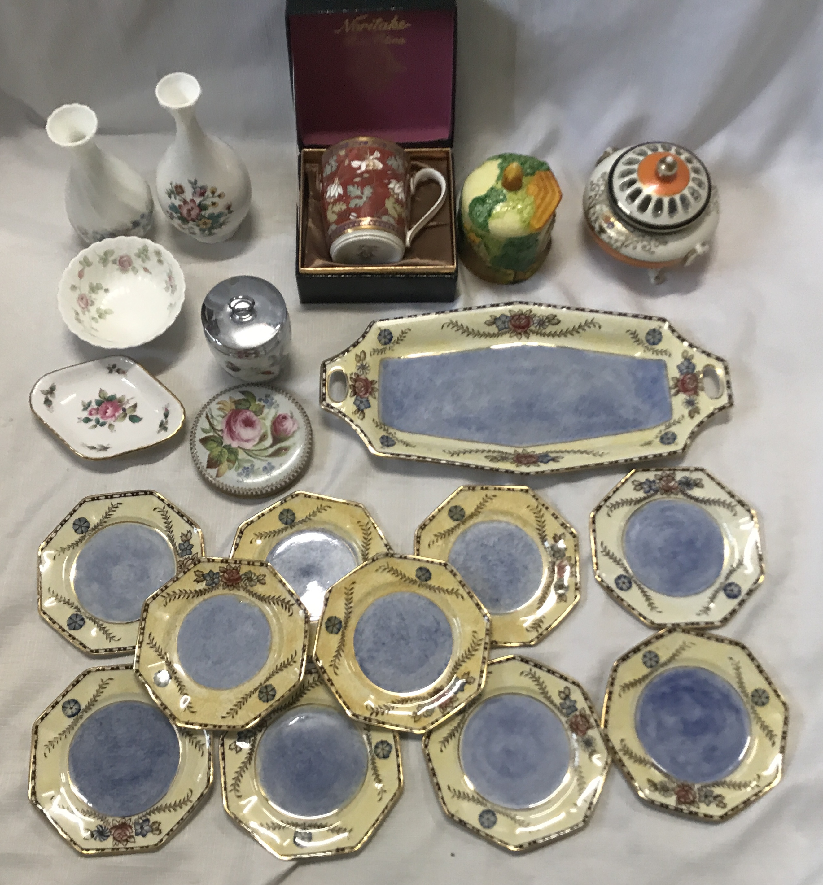 A pottery selection to include a boxed Noritake mug, a Coalport vase , a Wedgewood Angela vase 14cms