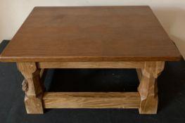 A medium oak Robert (Mouseman) Thompson footstool with adzed top. 40cms x 28cms x 20cms h.