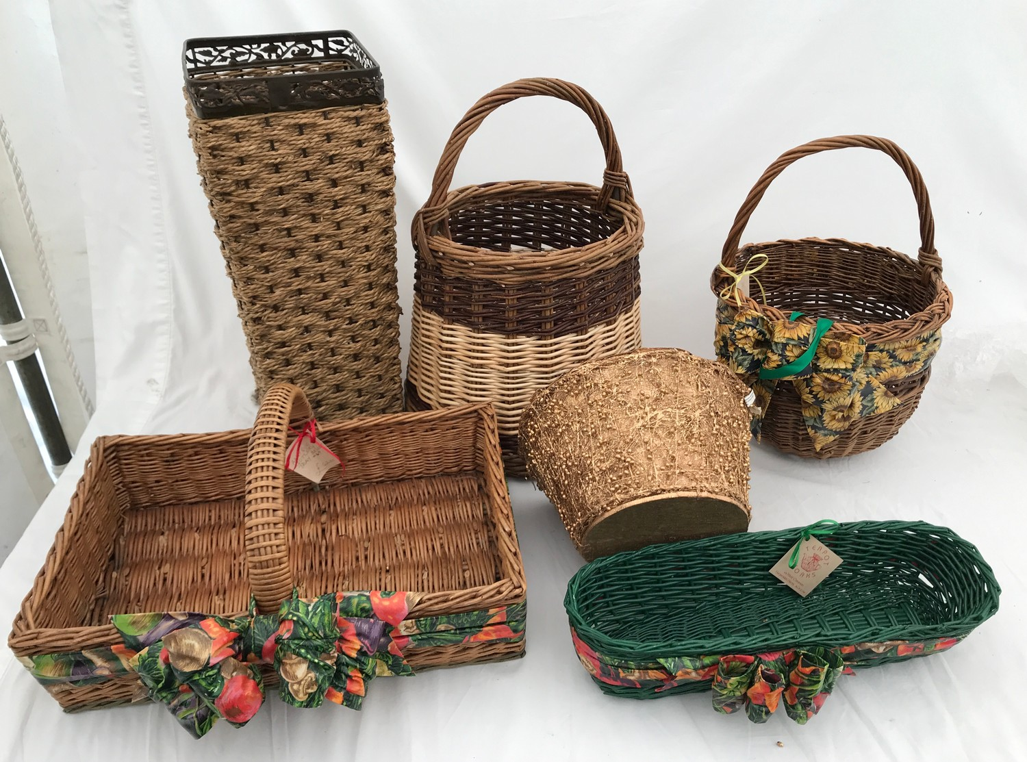 A selection of wicker baskets including a cutlery basket, french bread basket and others.Condition