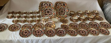 A large quantity of Royal Crown Derby tea and coffee service to include 14 coffee cans and