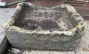 Two stone troughs. 48cms w x 38cms d x 25cms h and 53cms w x 41cms d x 19cms h.Condition