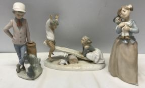 Three Nao Lladro figurines : Girl with Clown Doll 22.5cms h, Boy with Dog 23cms h and Boy and Girl