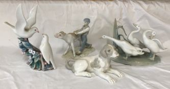 A group of Lladro and Nao Llado figures to include: Nao Grey and White Dog 10cms h x 18,5cms l,