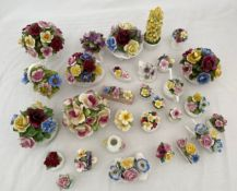 A collection of pottery posies, various makes, Aynsley Radnor, Royal Adderley, Coalport and others.
