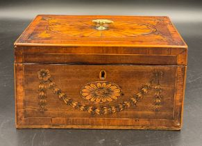 A late 18thC Sheraton mahogany tea caddy, finely inlaid with garland and floral panels with an