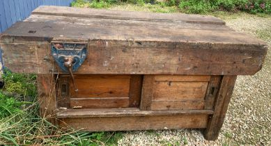 A vintage wooden workbench with cupboards to base at both sides. 153 x 78 x 78cms h with two