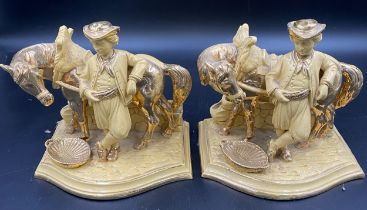 A matching pair of Eichwald figures of a man with a horse.Condition ReportSome rub to the gilt on