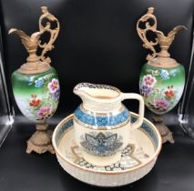 A W.T. Copeland & Sons primrose jug and bowl, jug 28cms h bowl 38cms d together with a pair of