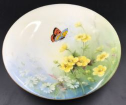 A Royal Worcester pedestal dish with floral and butterfly decoration. 23cms d x 5cms h.Condition