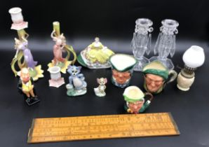 A mixed lot to include a pair of Continental pottery figurine candlesticks 19.5cms h, a small