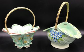 Two Burslem floral painted ceramic baskets with wicker handles. Tallest 27cms h.Condition ReportGood