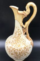 A Royal Worcester dragon handled ewer with gilt floral decoration.Condition ReportGilt rub to base
