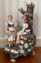A late 19thc German faience group. 50cms h.Condition ReportHairline crack to base.