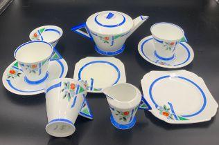 A Shelley part Art Deco period tea service to include a teapot, milk, sugar, 3 cups, 2 saucers, 1