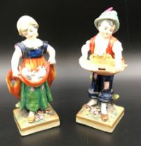 A pair of Sitzendorf figurines, boy 14.5cms h, girl with ducks 14cms h.Condition ReportMinor chips
