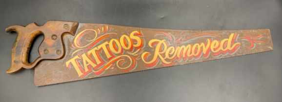 A vintage saw with painted decoration to one side 'Tattoos Removed' 68cms l.Condition ReportGood