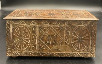 A vintage biscuit tin in the form of a carved oak coffer. 27 x 12 x 12cms h.Condition ReportGood