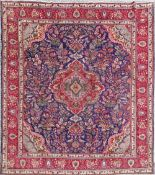 A VINTAGE HAND KNOTTED PERSIAIN TABRIZ FLOOR RUG, with multiple borders, a centre blue ground with