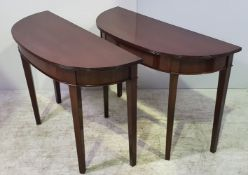 A PAIR OF LATE 19TH CENTURY MAHOGANY DEMI LUNE SIDE TABLES, with reeded detail to the edge, raised