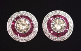 A GLAMOUROUS PAIR OF 18CT WHITE GOLD ART DECO INSPIRED RUBY & DIAMOND TARGET STUD EARRINGS, with a