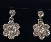A BEAUTIFUL PAIR OF 18CT WHITE GOLD DIAMOND DAISY DROP EARRINGS, total diamond weight 1.50cts, the
