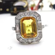 A STUNNING VINTAGE PLATINUM YELLOW CUSHION CUT SAPPHIRE & DIAMOND RING, the beautiful piece features