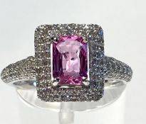 AN 18CT WHITE GOLD PINK SAPPHIRE & DIAMOND CLUSTER RING, the exquisite pink Sapphire is of very high