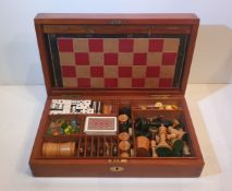 A RARE 19TH CENTURY MAHOGANY GAMES BOX, including contents, with chess, draughts, 3 board games