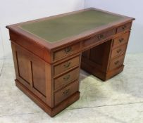 A GOOD QUALITY 19TH CENTURY WALNUT LEATHER TOPPED PEDESTAL DESK, with three drawers to the top