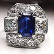 A STUNNING STATEMENT SAPPHIRE & DIAMOND RING, set in Platinum, with natural emerald cut sapphire