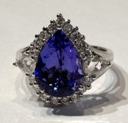 AN EXCEPTIONAL 18CT WHITE GOLD PEAR SHAPED TANZANITE RING, the 5.