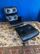 A MID CENTURY MODERN STYLE RECLINCING EASY CHAIR AND FOOT STOOL,