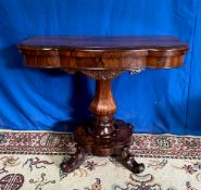 A VERY FINE LATE 19TH CENTURY ROSEWOOD FOLD OVER TEA TABLE, with