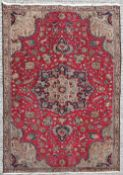 A GOOD VINTAGE HAND KNOTTED PERSIAN TABRIZ RUG, main field colour