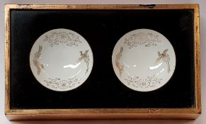 A CASED PAIR OF JAPANESE BOWLS, each bowl is decorated with a pai