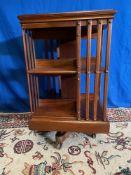 A GOOD QUALITY MAHOGANY REVOLVING BOOKCASE, with slatted sides to