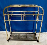 A LATE 19TH CENTURY BRASS UMBRELLA / STICK STAND, with curved fra